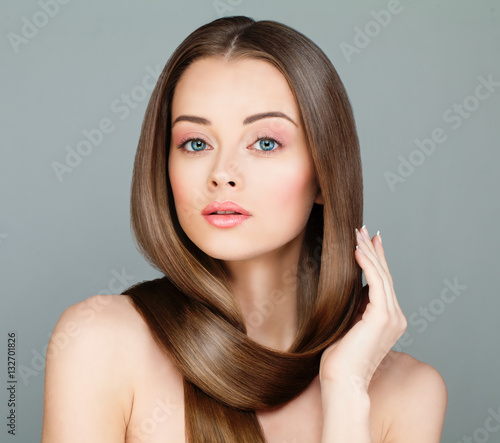 Woman with Long Healthy Hairstyle. Beautiful Model with Brown Ha