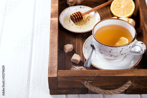 Poster Cup of Ginger Tea with Lemon and Honey on a White Background