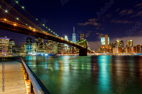 Poster Brooklyn Bridge over East River night in New York City
