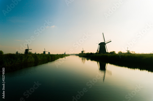 Traditional dutch windmills in countryside at Kinderdijk, Rotter Poster
