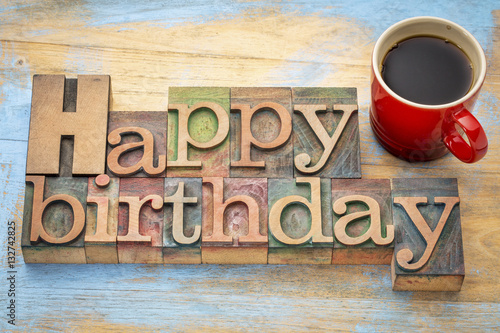 Happy Birthday in wood type with coffee