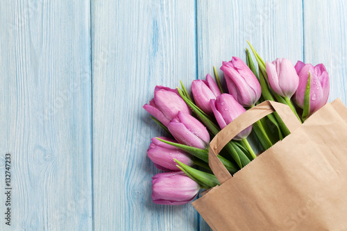 Fresh pink tulip flowers in paper bag
