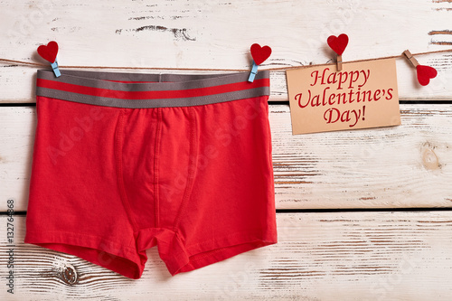 Poster Boxer briefs on wooden surface