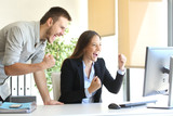 Excited businesspeople online