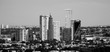Several tall buildings black and white