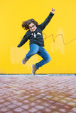 Happy boy jumping.