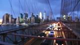 View of Brooklyn Bridge at night with car traffic