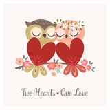 Greeting card with two cute owls in love sitting on flower branch for Valentines day or wedding congratulations.