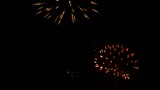 Colorful fireworks in dark night sky.