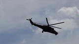 Two military helicopters flying. Black silhouettes in the sky