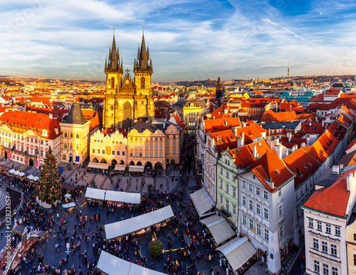 Foto op Aluminium Beijing Old Town of Prague, Czech Republic. View on Tyn Church and Jan Hus Memorial on the square as seen from Old Town City Hall during Christmas market. Blue sunny sky