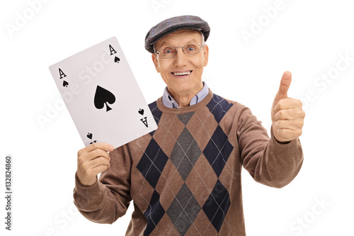 Poster Senior holding ace of spades card and making thumb up sign