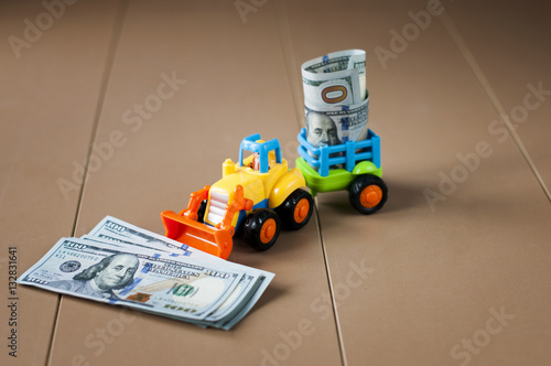 Poster toy tractor with money on table