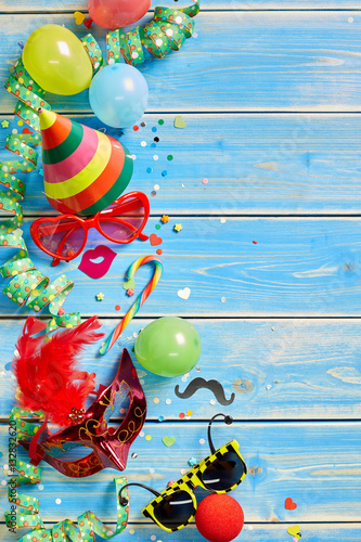 Colorful party objects over blue wooden background