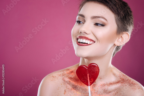 Poszter Positive woman posing with lollipop