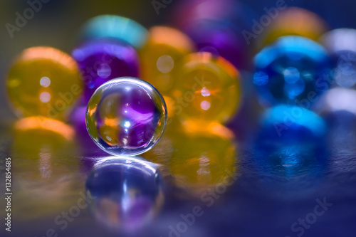 Poster Blue-purple orb with reflection, against a background of colorful balloons, abst