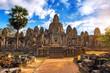 Ancient stone faces at sunset of Bayon temple, Angkor Wat, Siam