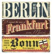 Vintage tin sign collection Germany cities. Berlin. Frankfurt. Bonn. Germany. Capital. Retro souvenirs or postcard templates on rust background.