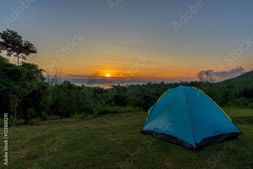 Poster Tourist tent in camp among meadow in the mountain at sunrise