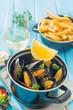 Mussels served with french fries and wine