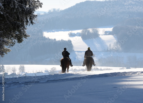 Poster rider in the snow, 2 riders in the cold and snowy winter landscape