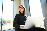 Hipster Girl use Laptop huge Loft Studio.Student Researching Process Work.Young Business Woman Working Creative Startup modern Office.Analyze market stock,new strategy