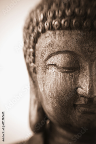 Fotobehang Boeddha Face of Buddha, This is a close-up photograph of an antique wood carving of a sculpture of Buddha