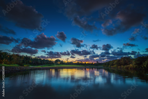 Beautiful sunset over the lake near the golf course in a tropica © ValentinValkov