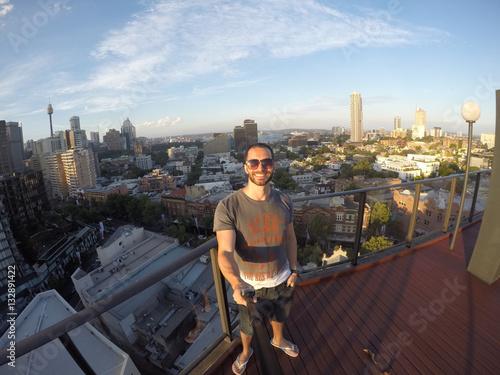 Poster Man taking a selfie with Sydney Skyline on background, Australia