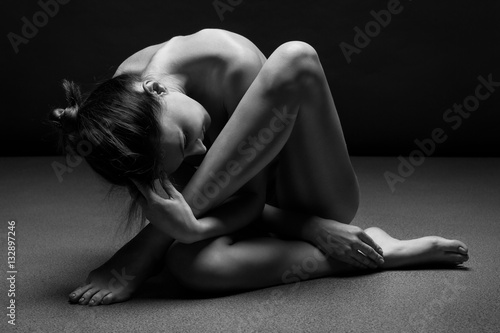 Plagát Naked woman body sculpture. Fine art photo of female body.