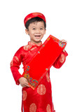 Happy Vietnamese boy in red Ao Dai celebrating New Year with con with con