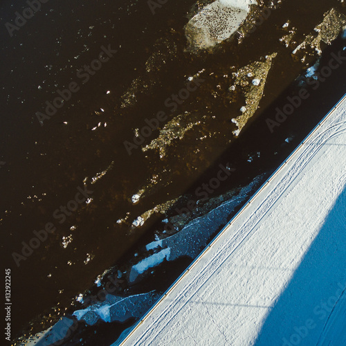 Winter river with ice floes, drone aerial image Poster