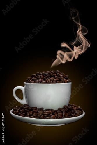 Fotobehang Koffiebonen Coffee cup full of coffee beans with smoke.
