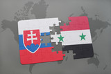puzzle with the national flag of slovakia and syria on a world map