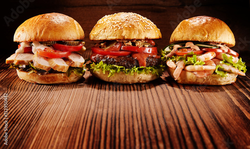 Three shrimp, beef and chicken burgers