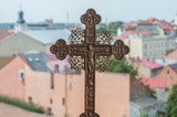 Greek Catholic cross on the background of the city