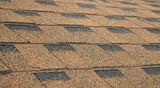 Asphalt Shingles Soft Focus Photo. Close up view on Asphalt Roofing Construction