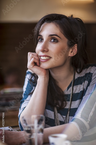 Poster Smiling Woman at a Cafe