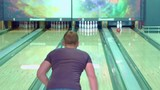Blond guy moonwalking at the bowling alley. Close up of young male bowler going backward near the lane. Attractive caucasian man missing the target