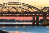 Spring evening in Nizhny Novgorod. Borsky bridge through Volga in the light of a decline