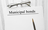 Paper with Municipal Bonds on a table