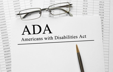 Paper with Americans with Disabilities Act (ADA) on a table