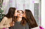 Girls kiss mother