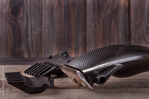hair trimmer on an old wooden background closeup Poster