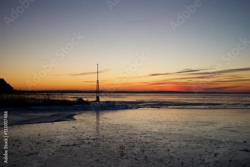 Lake Balaton completely frozen on sunset Poster