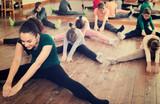 Friendly children with trainer stretching