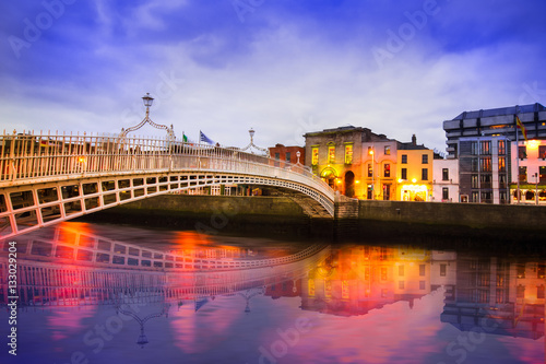 Ha'penny Bridge of the River Liffey in Dublin Ireland in the evening with lights Poster
