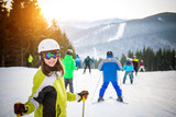Young woman is skiing in mountains