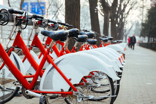 Deurstickers Peking Public Bike Rental Station in Beijing, China with Bicycles arranging in row ready for public rental