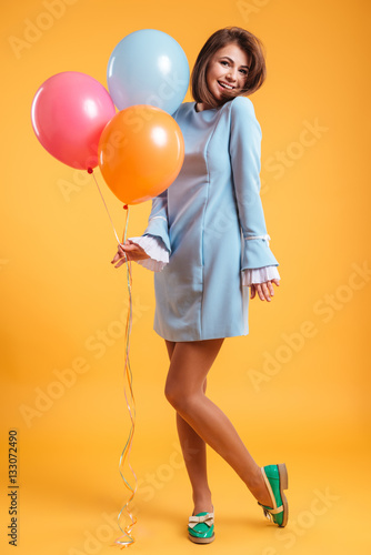 Full length portrait of happy young woman with colorful balloons Poster